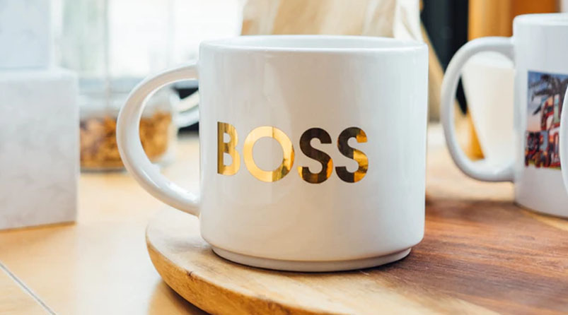 white mug with gold foil BOSS on wooden board